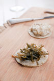Kelp seaweed salad on round canape Royalty Free Stock Images