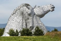 The Kelpies sculpture by Andy Scott in Helix Park, Scotland, United Kingdom. The Kelpies sculpture by Andy Scott in Helix Park, Scotland, United Kingdom Royalty Free Stock Image