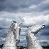 Kelpies in the storm royalty free stock photography