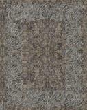 Keltisk lättnad som mejslas i granit Arkivfoto