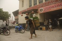 KELUD VOLCANO ERUPTION ASH RAIN. Market sellers are using respiratory masks after an ash rain that came from erupting nearby Kelud Volcano, in Solo, Java royalty free stock photo