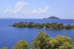 Kelyfos Island on the horizon of Aegean Sea. Stock Image