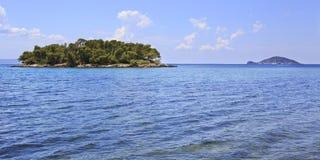 Kelyfos (Turtle) Island floating on the neighboring islands. Stock Image