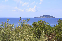Kelyfos (Turtle) Island on horizon of Aegean Sea. Stock Image