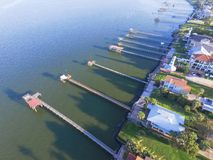 Kemah fishing piers aerial. Aerial view three-story waterfront vacation home with fishing piers stretching out over the Galveston Bay in Kemah city, Texas, USA Royalty Free Stock Images