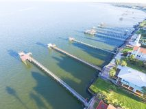 Kemah fishing piers aerial. Aerial view three-story waterfront vacation home with fishing piers stretching out over the Galveston Bay in Kemah city, Texas, USA Stock Photography
