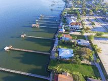 Kemah fishing piers aerial. Aerial view three-story waterfront vacation home with fishing piers stretching out over the Galveston Bay in Kemah city, Texas, USA Royalty Free Stock Image