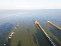 Kemah fishing piers aerial. Aerial view of fishing piers stretching out over the Galveston Bay in Kemah city, Texas, USA. Bird eye view of Kemah Lighthouse Royalty Free Stock Photos
