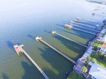 Kemah fishing piers aerial. Aerial view three-story waterfront vacation home with fishing piers stretching out over the Galveston Bay in Kemah city, Texas, USA Stock Photo