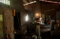 Kemaman, Terengganu, Malaysia - April 04.2015 A BLACKSMITH MAKING KNIFE WITH TRADITIONAL WAY Stock Photo