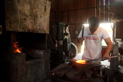 Kemaman, Terengganu, Malaysia - April 04.2015 A BLACKSMITH MAKING KNIFE WITH TRADITIONAL WAY Stock Image