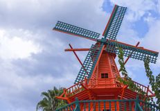 KEMER, TURKEY - SEPTEMBR 30, 2017: Windmill in the Amsterdam Centraal hotel. KEMER, TURKEY - SEPTEMBR 30, 2017: Orange windmill in the Amsterdam Centraal hotel Stock Image