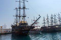 KEMER, TURKEY - 11,08,2017 Tourist pirate ships in the port of K. Emer Royalty Free Stock Photos