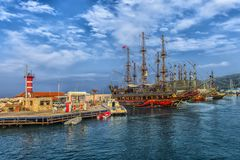KEMER, TURKEY - 11,08,2017 Tourist pirate ships in the port of K Stock Photo