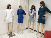 Four female mannequins dressed in various female clothes stand in the corner in the Ostin shop. KEMEROVO, RUSSIA, JANUARY 20, 2019. Four female mannequins stock photos