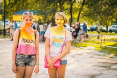 Kemerovo, Russia, June 24, 2018: Young girls painted with colored powder after holi festival colors stock photography