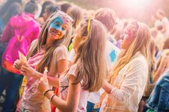 Kemerovo, Russia, June 24, 2018: Young girls painted in colored powder royalty free stock image