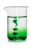Kemisk flaska med grön flytande royaltyfria bilder