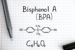 Kemisk formel av Bisphenol A BPA med den svarta pennan Arkivbild
