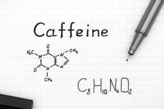 Kemisk formel av koffein med den svarta pennan Royaltyfri Fotografi