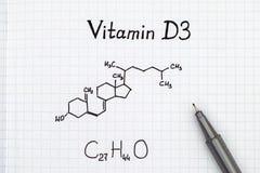 Kemisk formel av vitaminet D3 med pennan Fotografering för Bildbyråer
