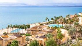 Kempinski spa resort and Dead Sea in winter day. DEAD SEA, JORDAN - FEBRUARY 19, 2012: Kempinski spa resort hotel Ishtar and Dead Sea in winter day. The Dead Sea Stock Images
