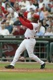 Ken Griffey Jr. of the Cincinnati Reds. Ken Griffey Jr of the Cincinnati Reds smacking the baseball for a base hit stock photo
