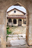 The kenassa building in Chufut-Kale in Crimea in spring. Chufut-Kale is a medieval city-fortress in the Crimean Mountains that now lies in ruins Royalty Free Stock Photo