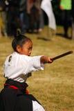 Kendo de ejecución de la muchacha japonesa, Tokio, Japón Imagen de archivo libre de regalías