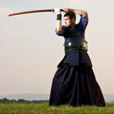 Kendo expert. Fighting with bokken Royalty Free Stock Image