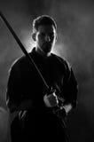 Kendo expert posing with bokken Stock Photos