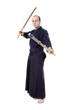 Kendo fighter. With bokken and shinai isolated on white Royalty Free Stock Photos