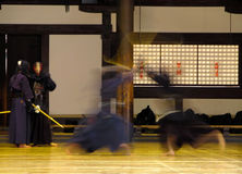 Kendo fighting. Aspect of a Kendo fighting in a traditional Japanese temple.The focus is not perfect but the subject is very special and in small size I think Royalty Free Stock Photos