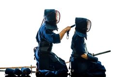 Kendo martial arts fighters silhouette isolated white bacground royalty free stock photography
