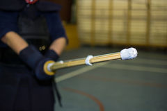 Kendo shinai. Tip of shinai with kendo fighter in background Stock Photography