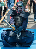 Kendo Warrior on His Knees fighting in Traditional Clothes and B Stock Image