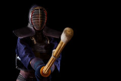 Kendo warrior in traditional dress on a black background stock photos