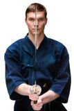 Kendoka in hakama training with sword Stock Photos