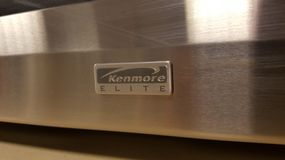 Kenmore Elite. Walnut Creek, United States - September 7, 2016: Embossed logo for the Kenmore Elite brand of kitchen appliances, on the stainless steel base of a Stock Photography