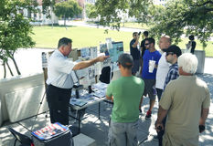 A Kennedy conspiracy theorist draws an crowd at the grassy knoll. Dallas TX USA Sept 21, 2014: Over 50 years after the assassination of President John F. Kennedy Stock Image