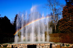 Kennett Square, PA: Longwood Gardens Fountains. A rainbow arcs over the 229 water jets comprising the spectacular Main Fountain Garden created in 1931 at Royalty Free Stock Photography