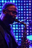 Kenny Garrett plays alto saxophone in front of large LED screen on stage during summer jazz festival OpenJazzFest Zelena Voda, Slo Stock Photo