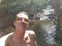 Kenny n sam. K n S playing in heavens creek cooling down and loving nature Stock Images