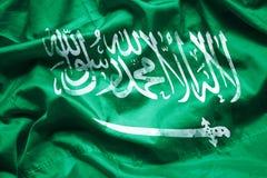 Kennzeichnen Sie Königreich Saudi-Arabien durch Aquarellpinsel auf Segeltuchgewebe, Schmutzart lizenzfreie stockfotos