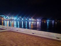 Kenosha Harbor Nightlights. Colored lights illuminate water at night Royalty Free Stock Photos