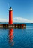 Kenosha, Wisconsin Pierhead Light. The bright red Pierhead Lighthouse at Kenosha, Wisconsin is reflected in early morning light on the waters of Lake Michigan Stock Photo