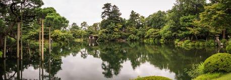 Panorama of the picturesque Kenroku-en gardens, Kanazawa, Ishikawa, Japan. Kenroku-en located in Kanazawa, Ishikawa, Japan, is an old private garden. Along with stock photos