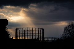Kensal Green gasometer silhouetted in front of angry sky Royalty Free Stock Photos