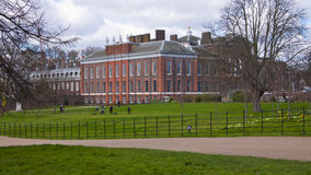 Kensington Palace and Gardens, London, England, United Kingdom. London, United Kingdom - March 31, 2015: Kensington Palace and Gardens. Incidental people Royalty Free Stock Photography