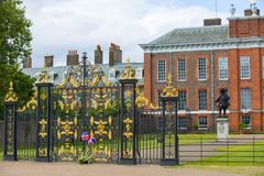 Kensington palace, in Hyde park view at sunny day with lots of people walking and resting in th, London UK Royalty Free Stock Photos